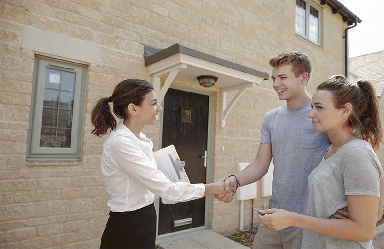 Couple meeting a real estate agent